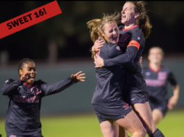 Excited women ebracing in a hug on a soccer field